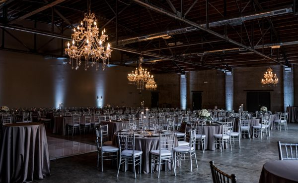 Brick_and_mortar_event_venue_wichita_ks_weddings_indoor_downtown_arena_district_gray_silver_tablecloth_decor_modern_classic