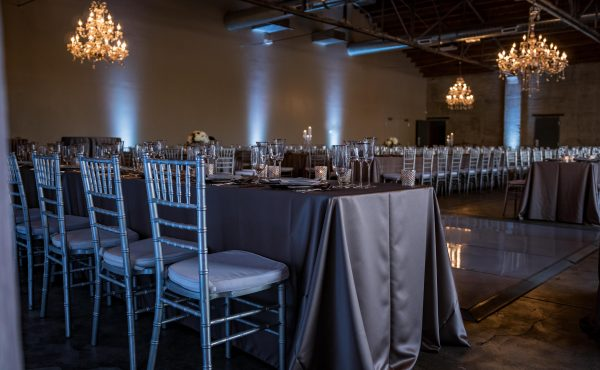 Brick_and_mortar_event_venue_wichita_ks_weddings_indoor_downtown_arena_district_gray_silver_tablecloth_decor_modern_classic_head_table